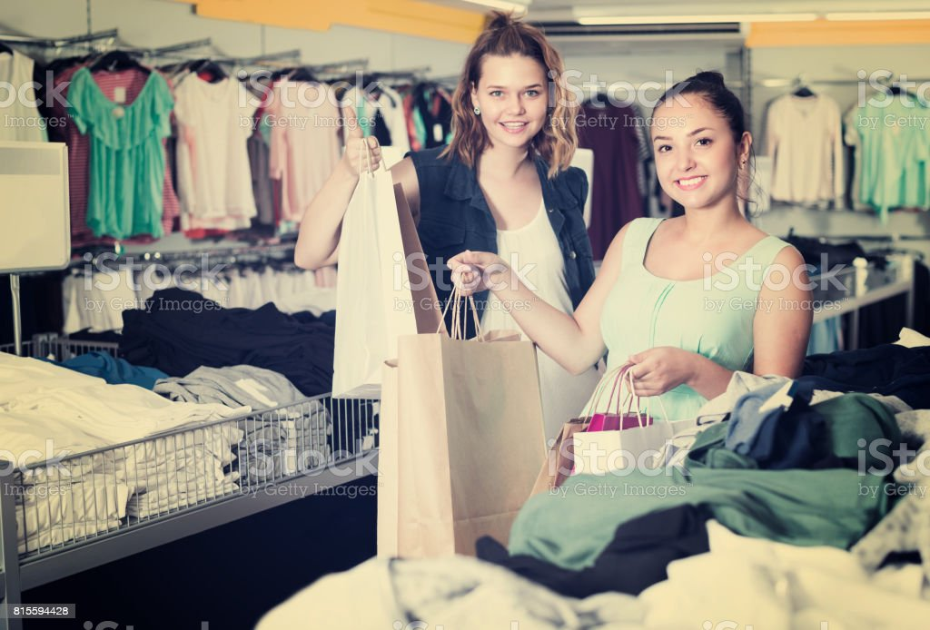 Female are holding purchases stock photo