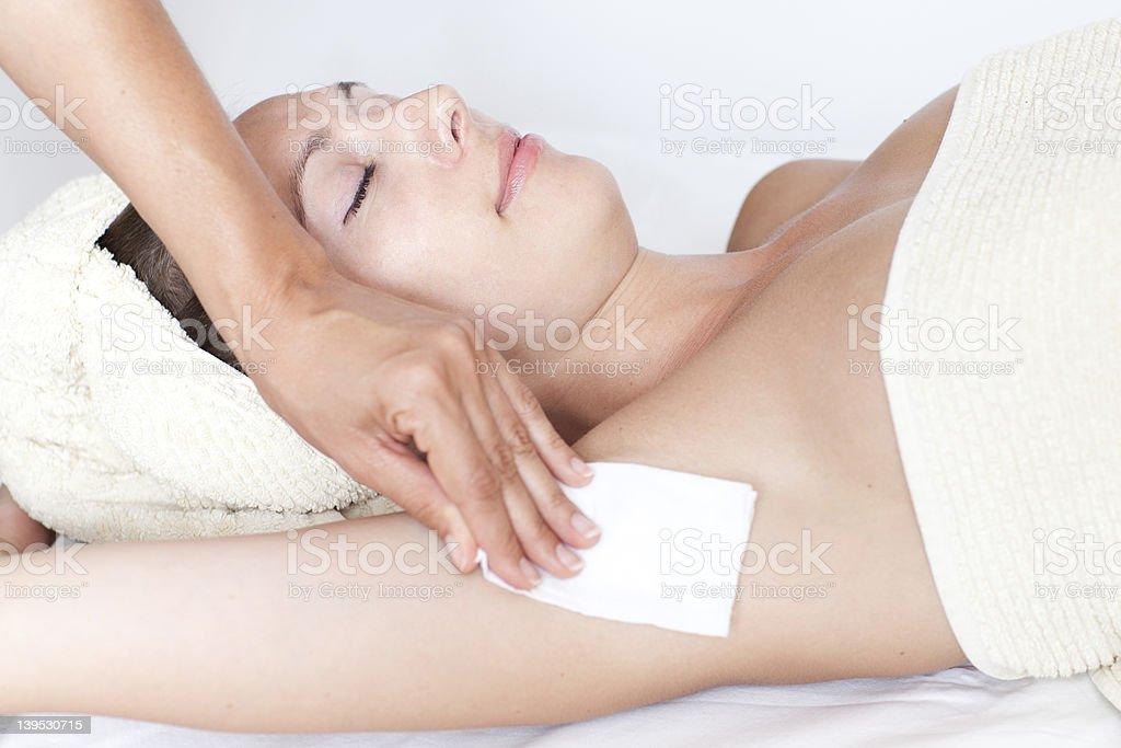 Female armpit depilation in a beauty salon royalty-free stock photo