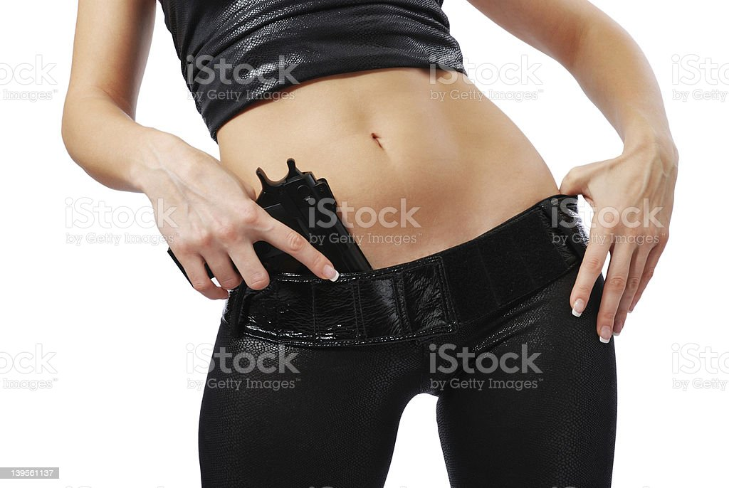 Female arms with pistol and sexy body in black leather. stock photo
