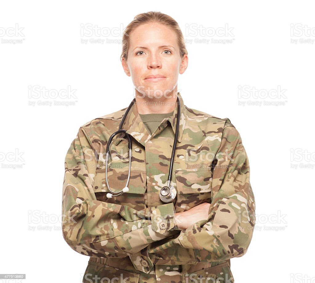 Female Army doctor in uniform looking serious. stock photo