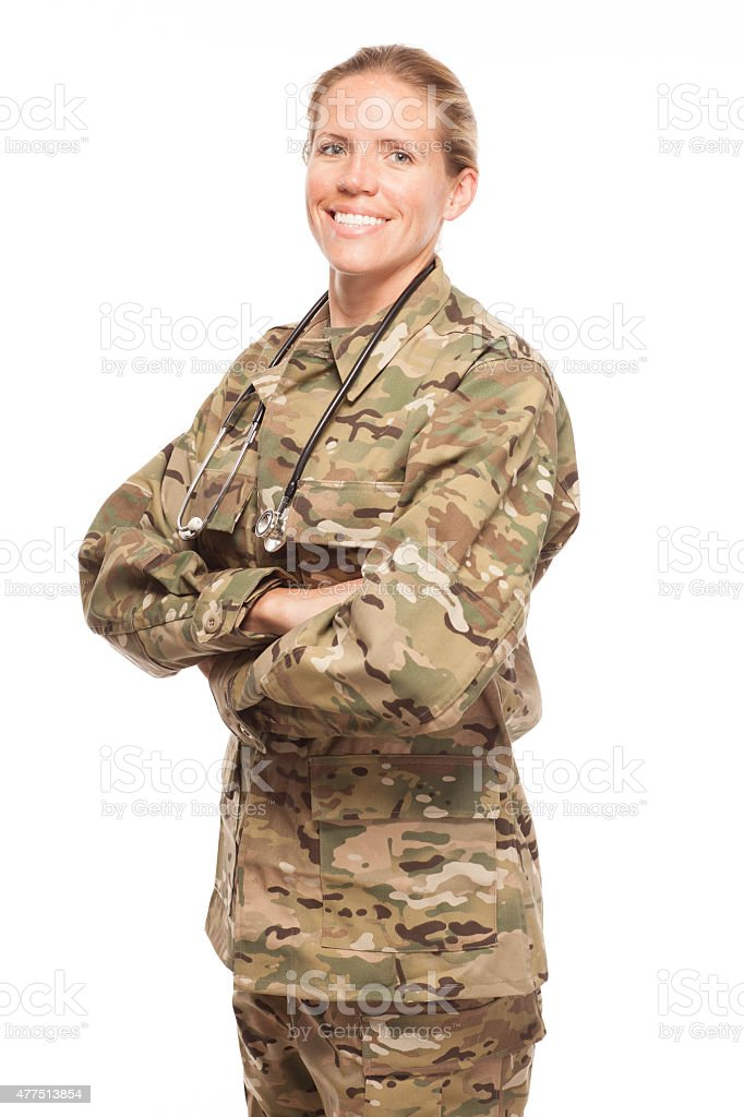 Female Army doctor in uniform with arms crossed. stock photo