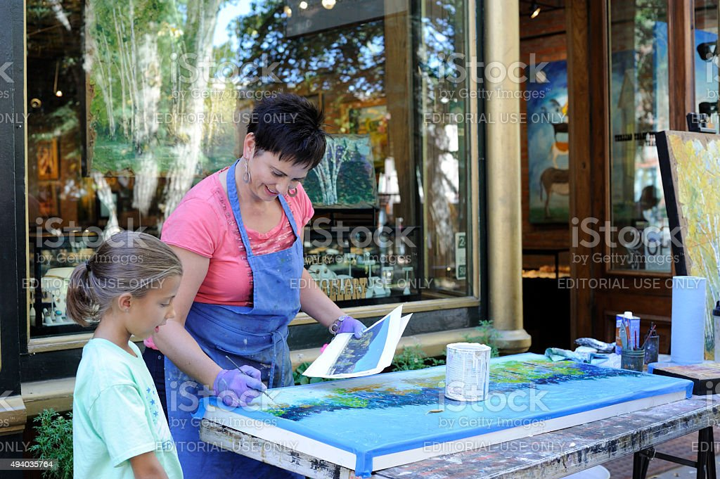 Female Artist Showing a Girl How to Paint in Aspen stock photo