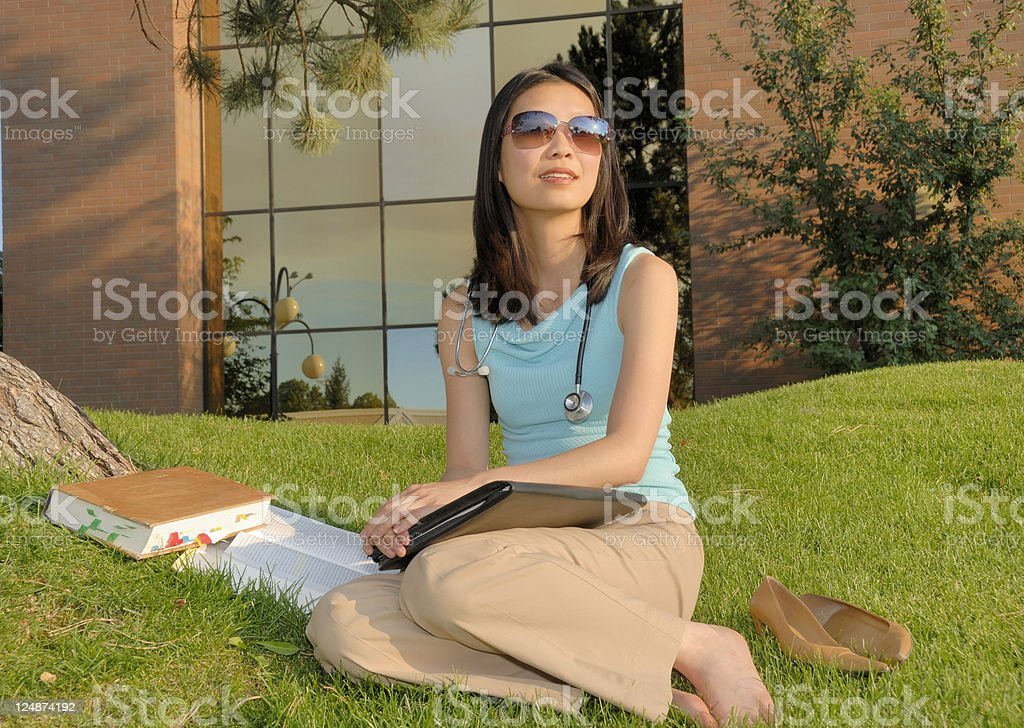 Female Asian Medical Student Taking A Break From Her Studies royalty-free stock photo