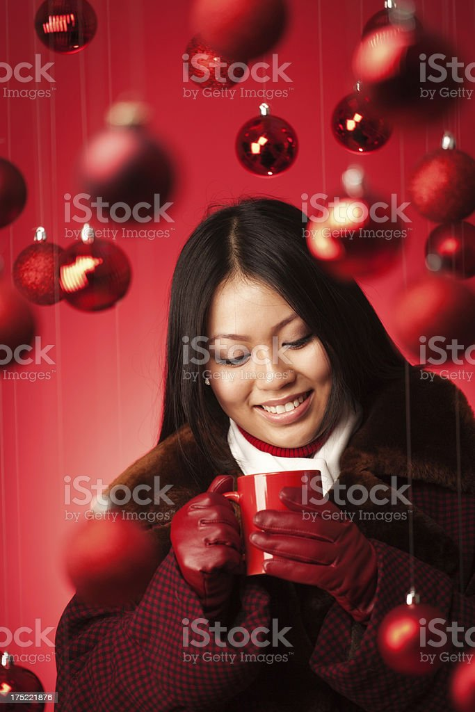 Female Asian Model in Winter Coat and Hot Christmas Drink royalty-free stock photo