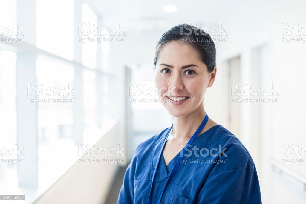 Female Asian nurse smiling towards camera, portrait stock photo