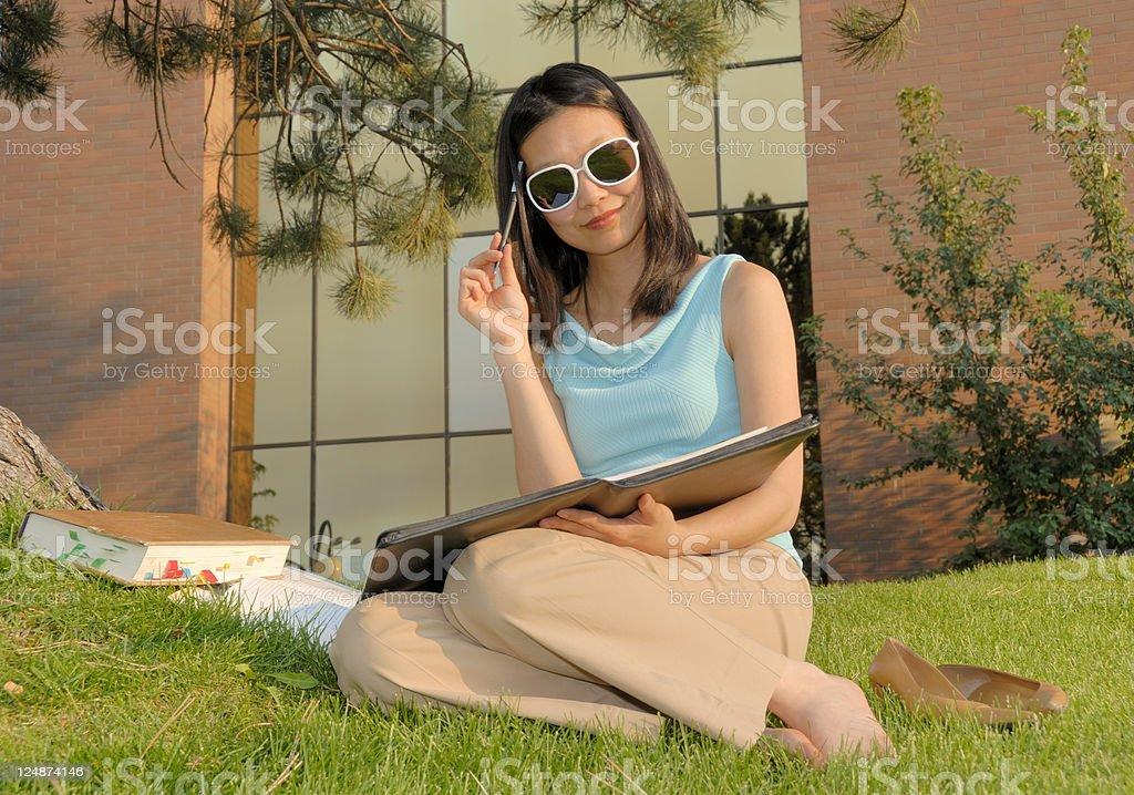 Female Asian Student Taking A Break From Her Studies stock photo