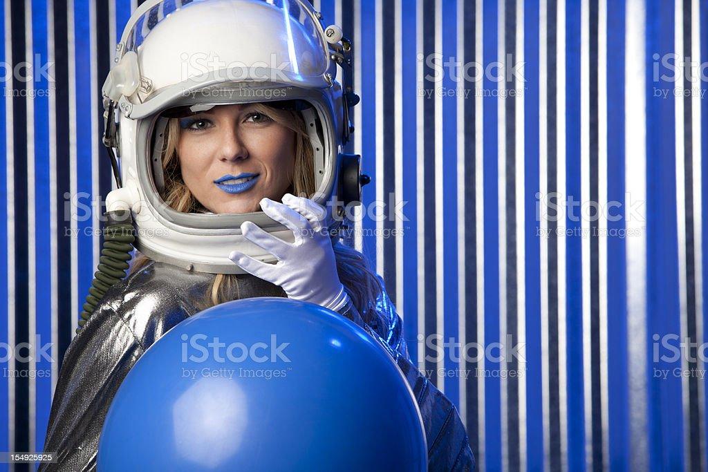 Female Astronaut Holding Blue Ball stock photo