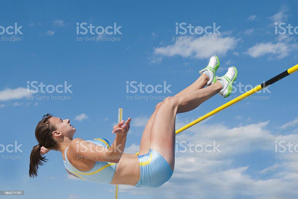 Female athlete at high jump stock photo