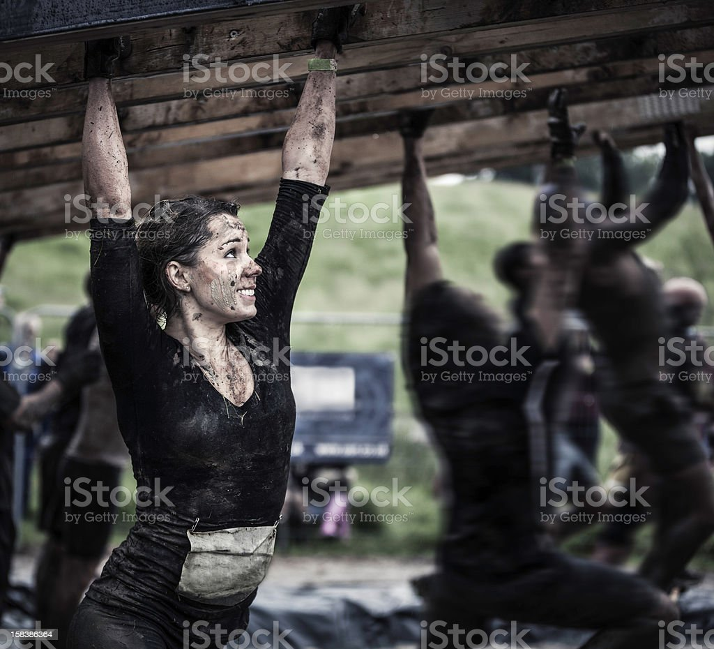 Female athlete competing in an obstacle course stock photo