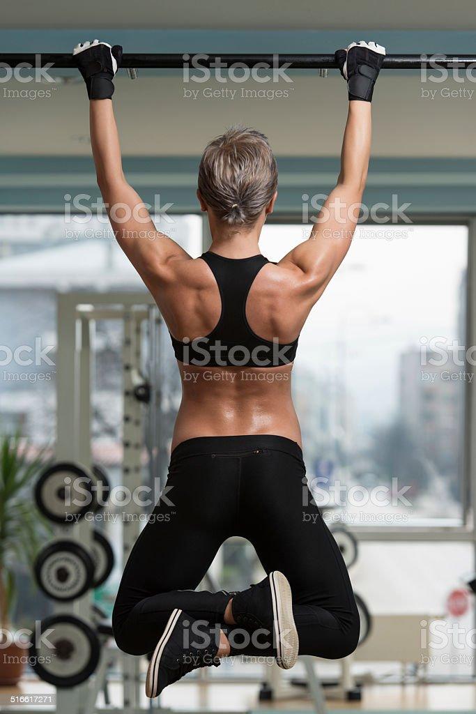 Female Athlete Doing Pull Ups stock photo