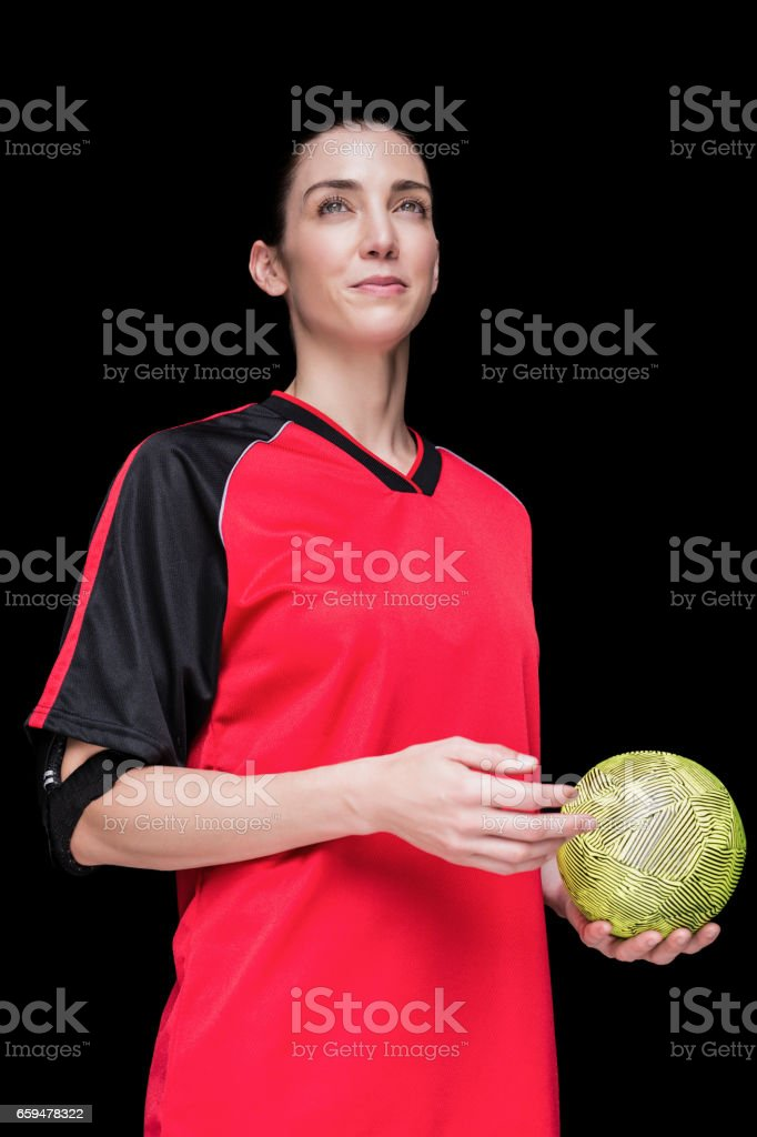 Female athlete holding a hand ball stock photo