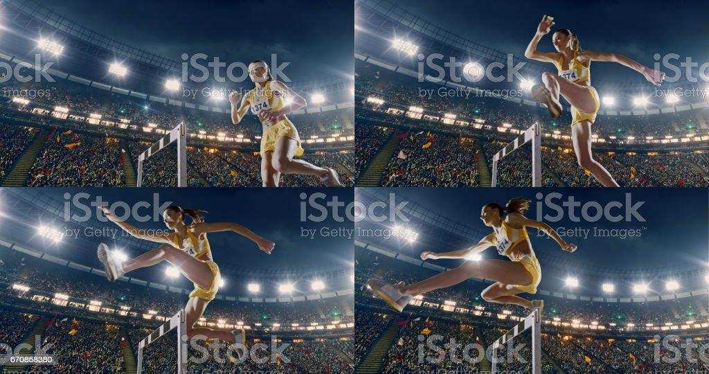 Female athlete hurdle on sports race stock photo