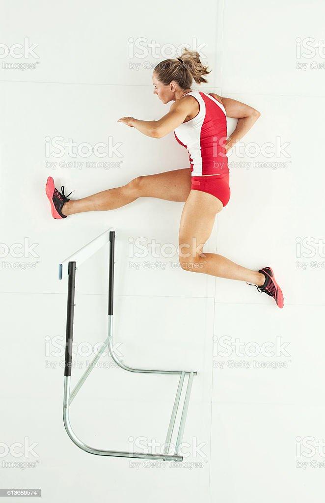 Female athlete hurdling stock photo
