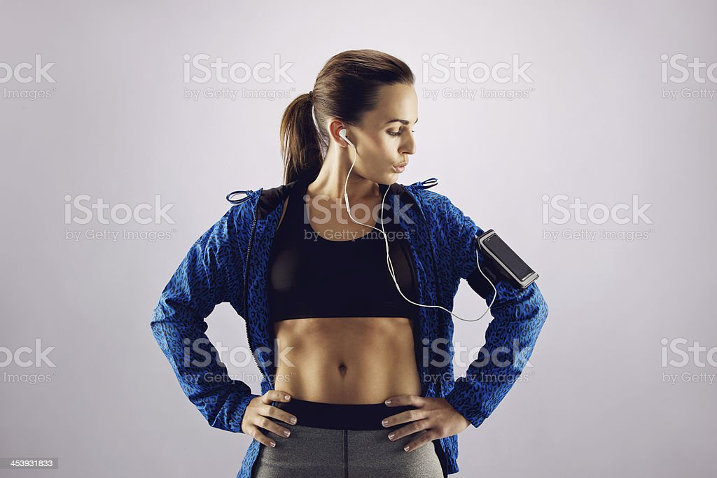 Female athlete listening music with cell phone stock photo