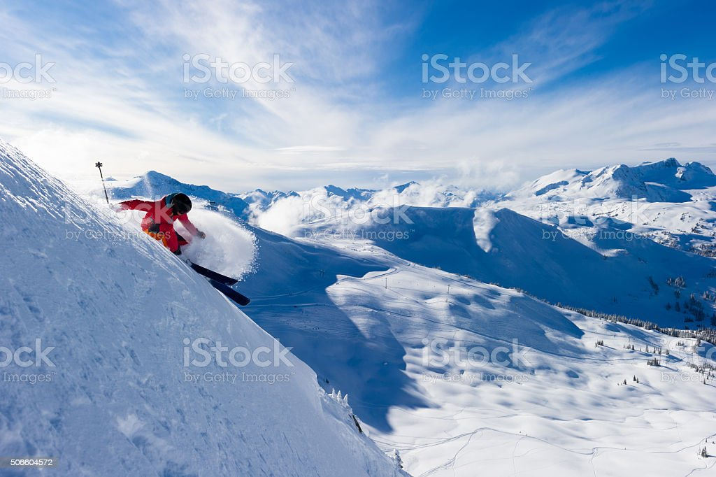 Female athlete making a powder turn stock photo