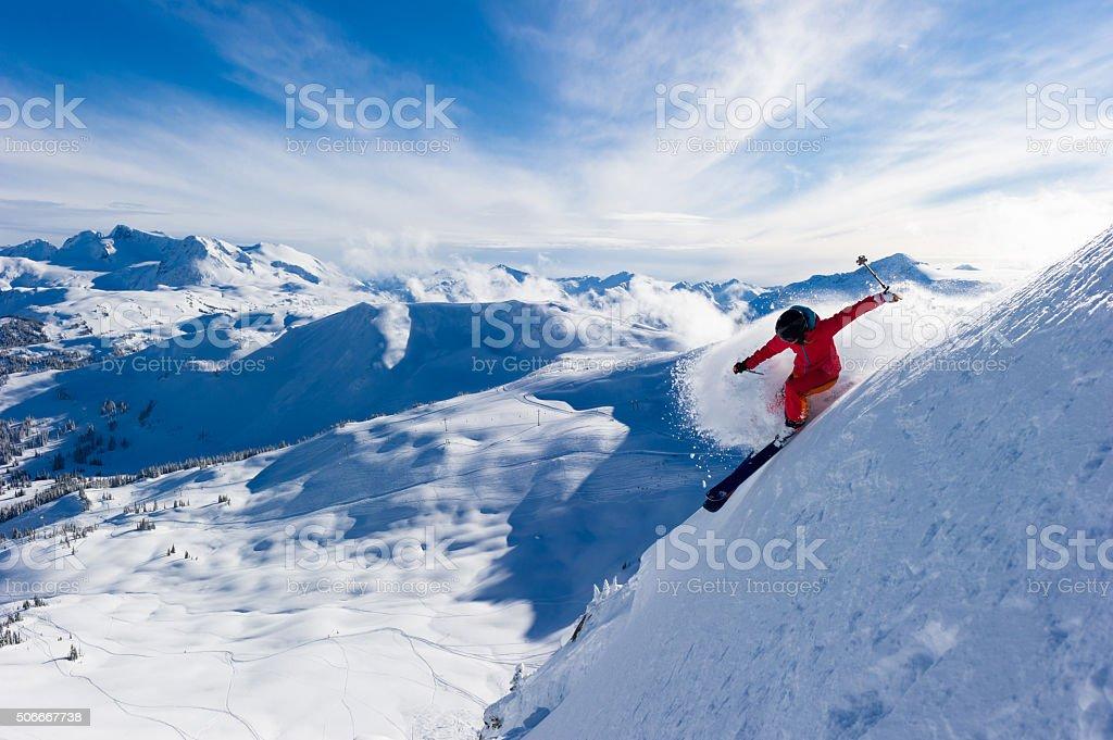 Female athlete making a powder turn stock photo