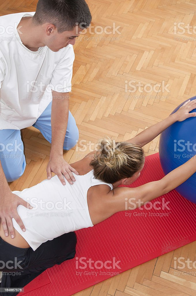 Female athlete on physical therapy stock photo
