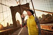 Female athlete on the bridge
