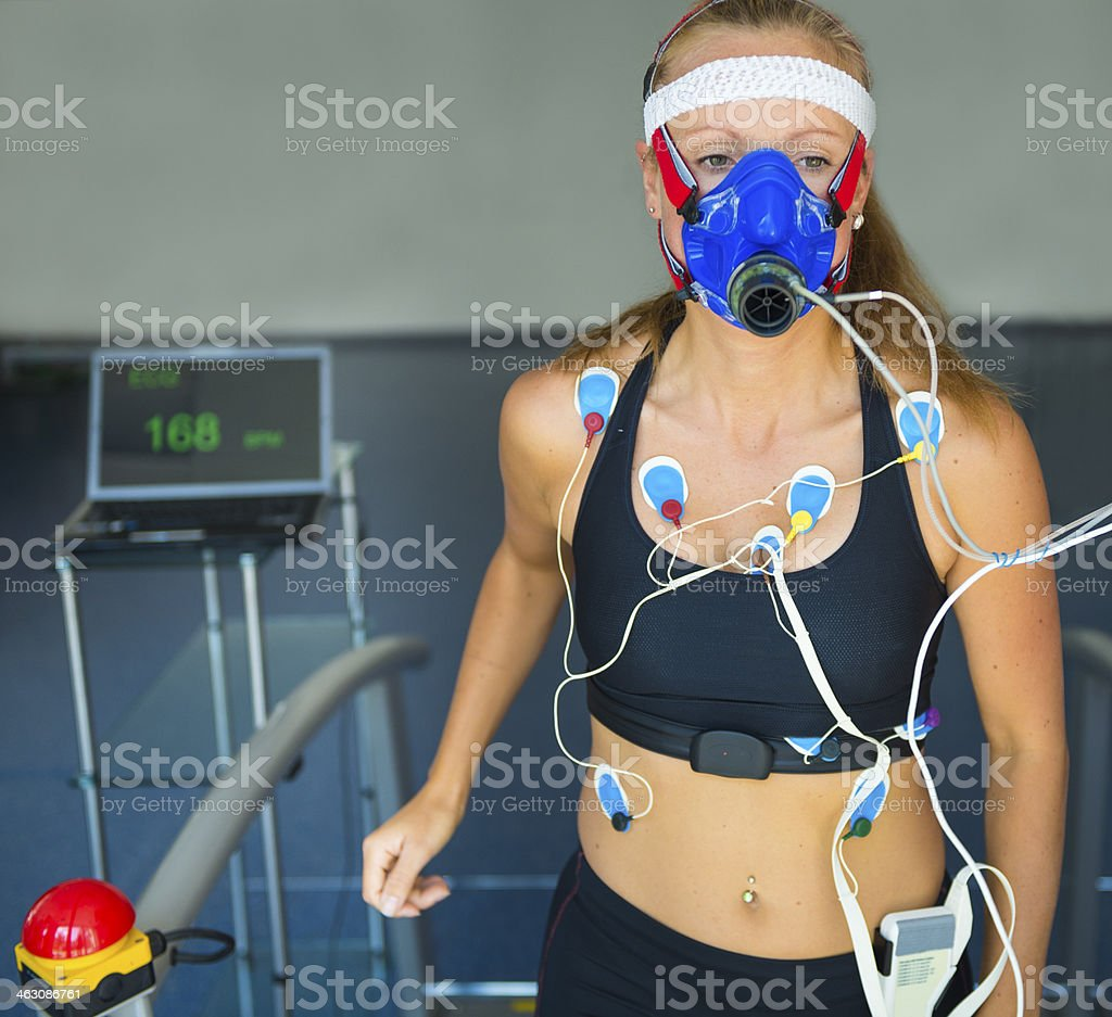 Female Athlete Performing ECG and VO2 test on Treadmill royalty-free stock photo