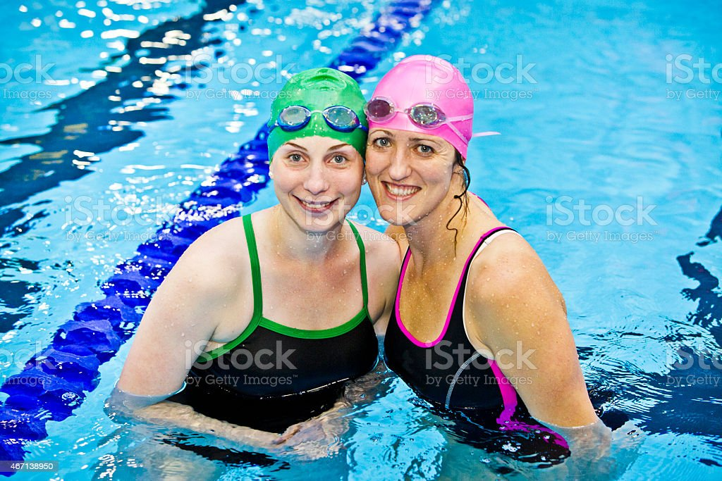 Female athlete portrait in indoor pool stock photo