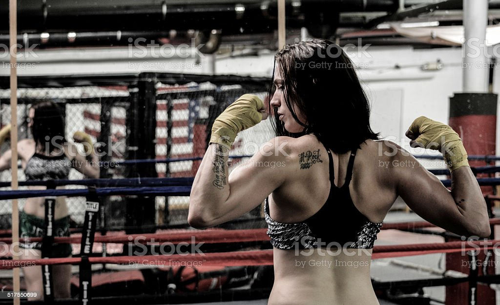 Female athlete posing in Boxing Ring stock photo