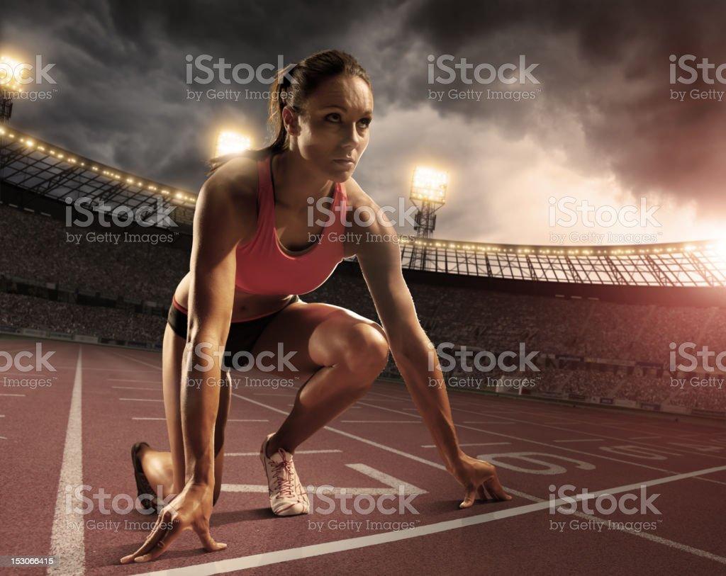 Female Athlete Prepares to Race stock photo