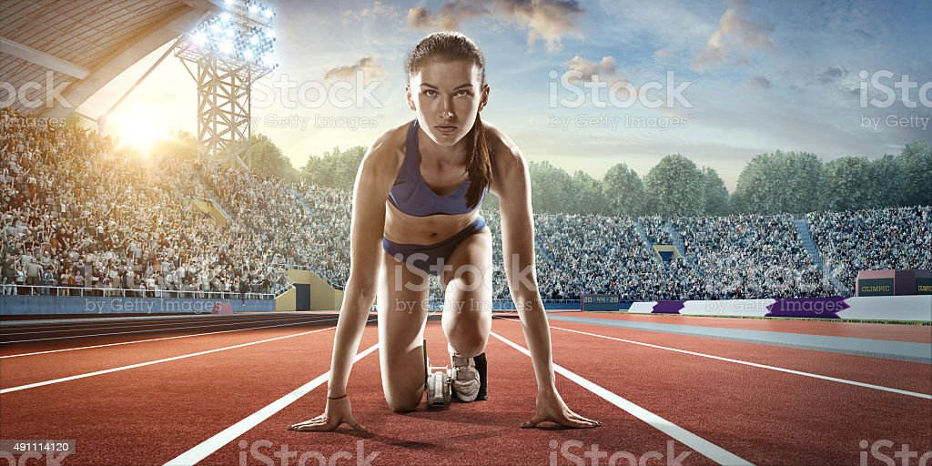 Female athlete prepares to run stock photo