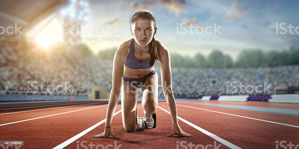 Female athlete prepares to run stock photo