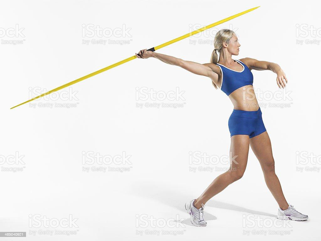 Female Athlete Preparing To Throw Javelin stock photo