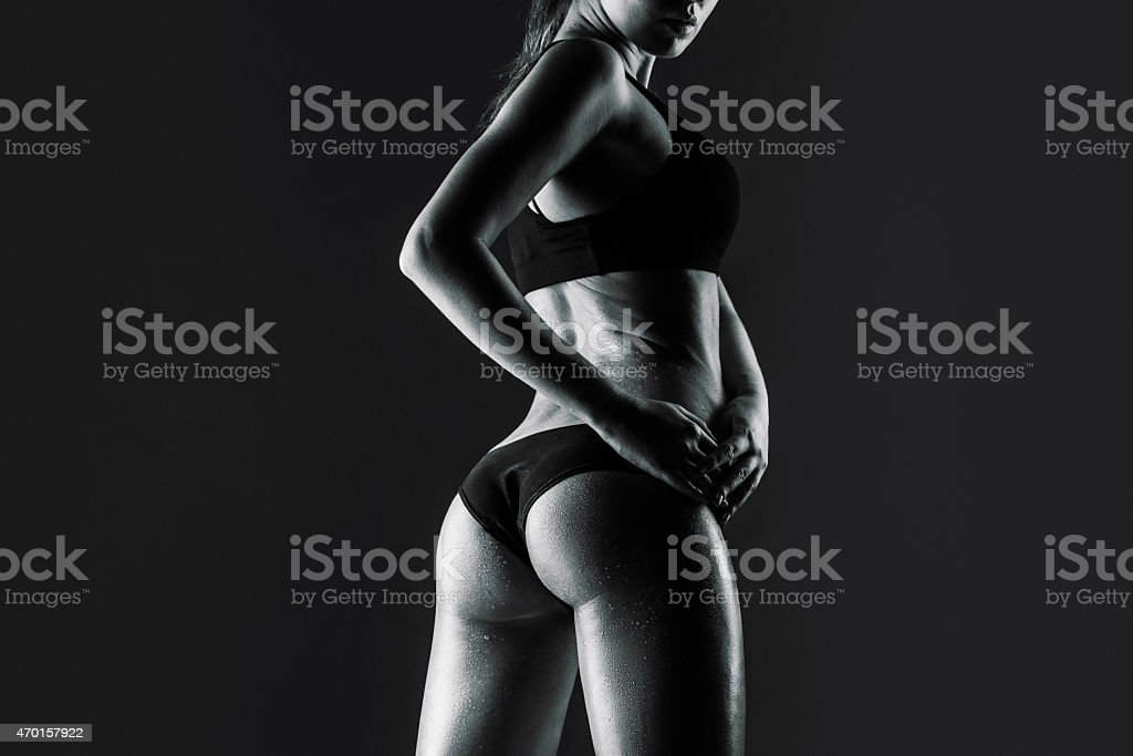 female athlete rear view, trained buttocks stock photo