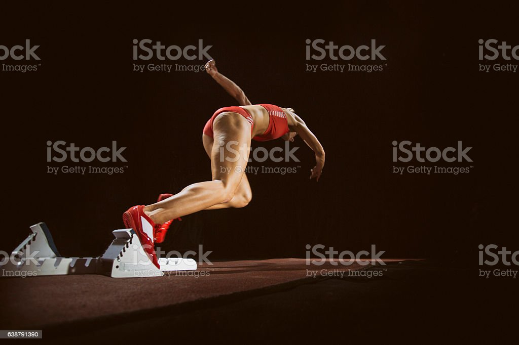 Female athlete running on track stock photo
