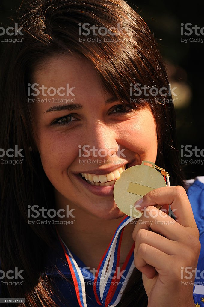 Female athlete showing gold medal royalty-free stock photo