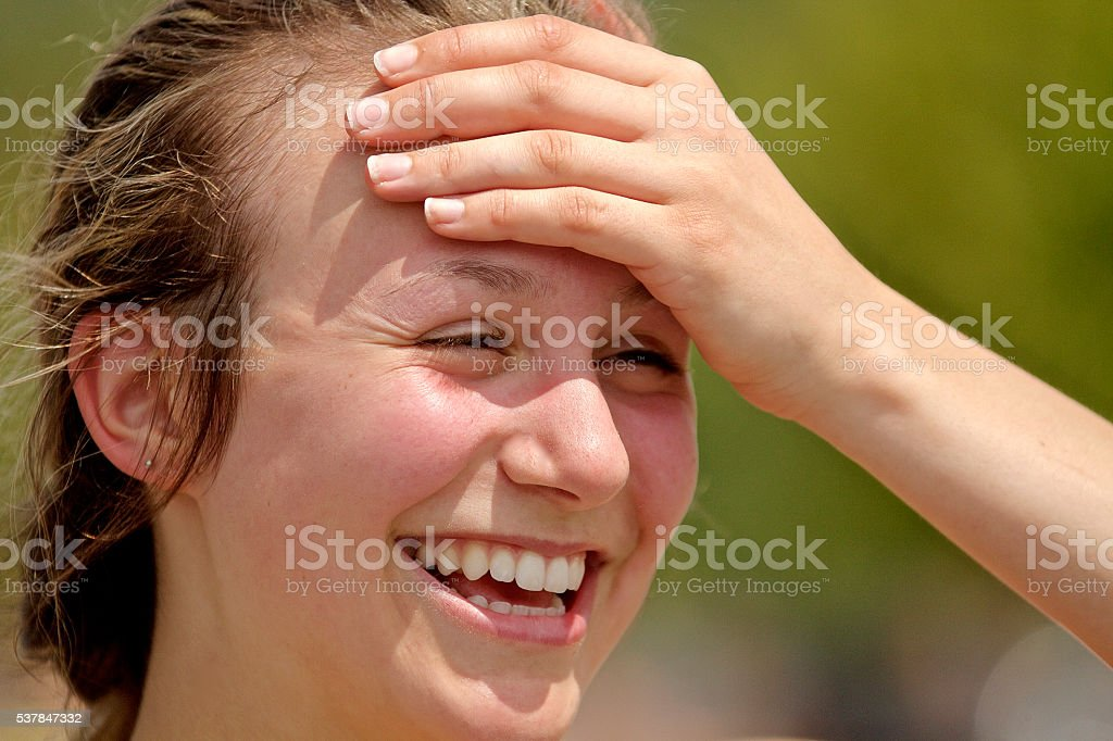 Female athlete smiling after race stock photo
