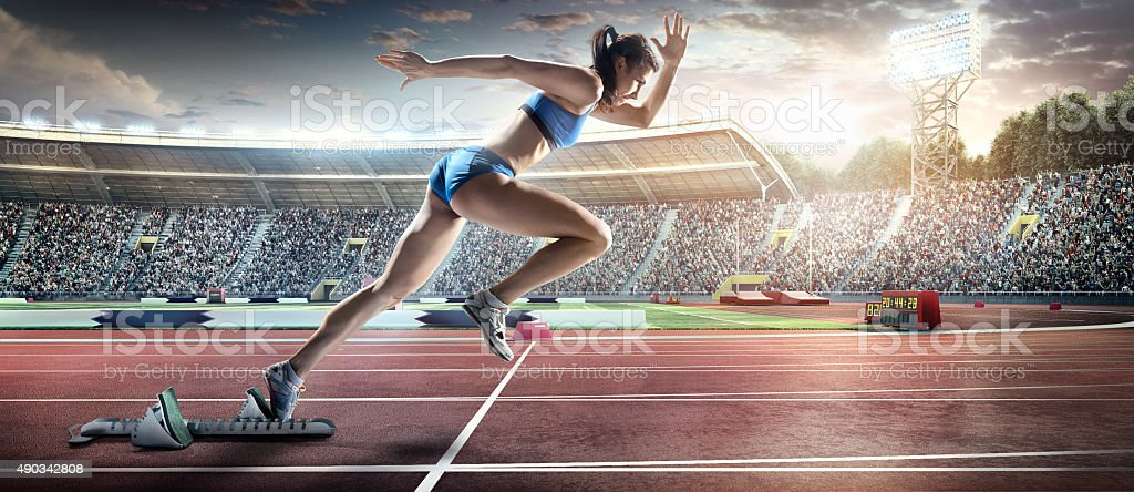 Female athlete sprinting stock photo