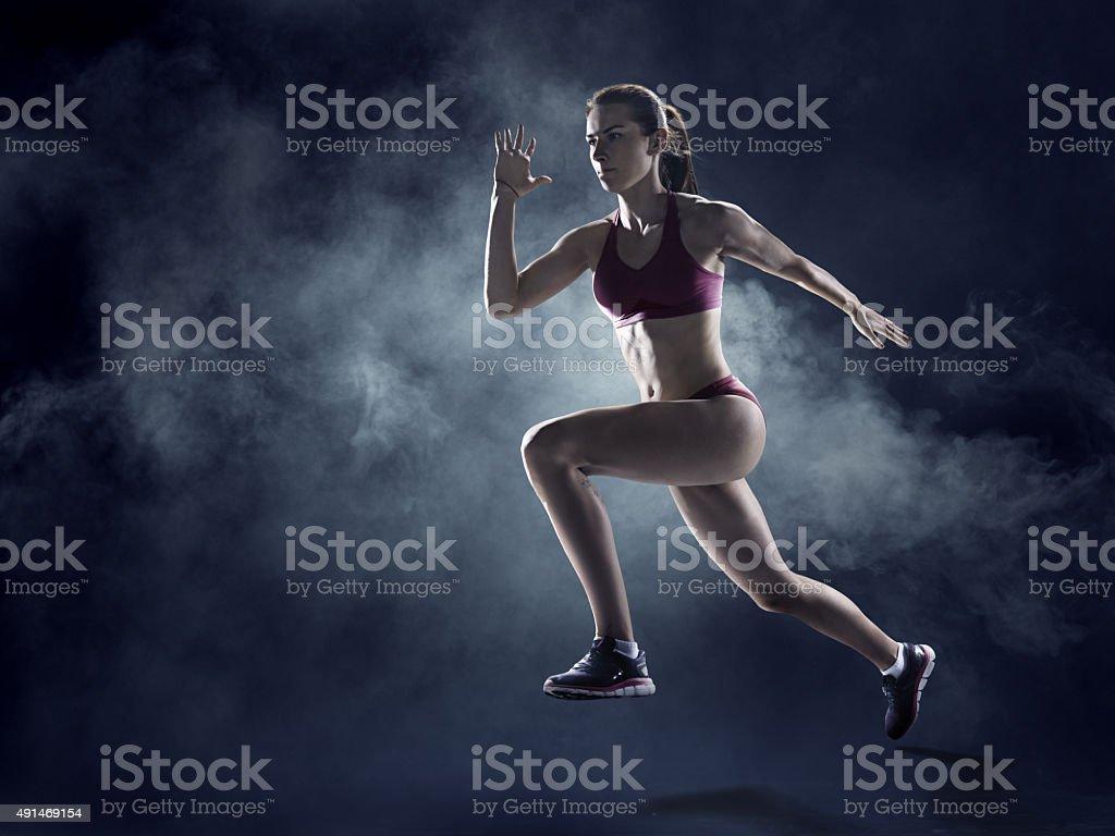 Female athlete sprinting stock photo