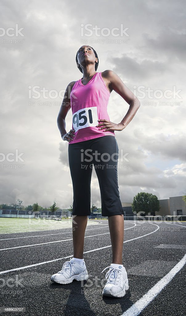Female Athlete Standing on Track Before Sports Race stock photo
