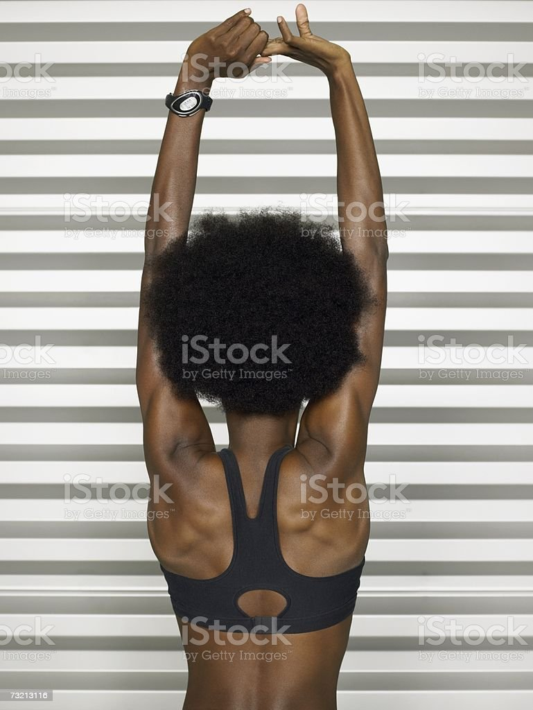 Female athlete stretching her arms royalty-free stock photo