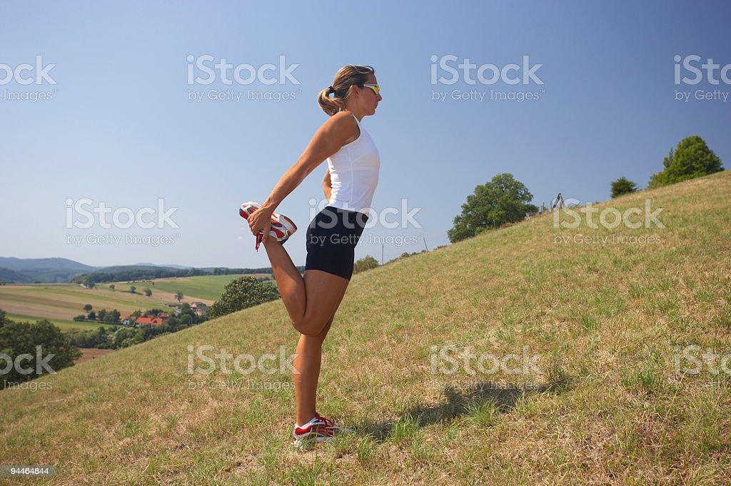 female athlete stretching royalty-free stock photo