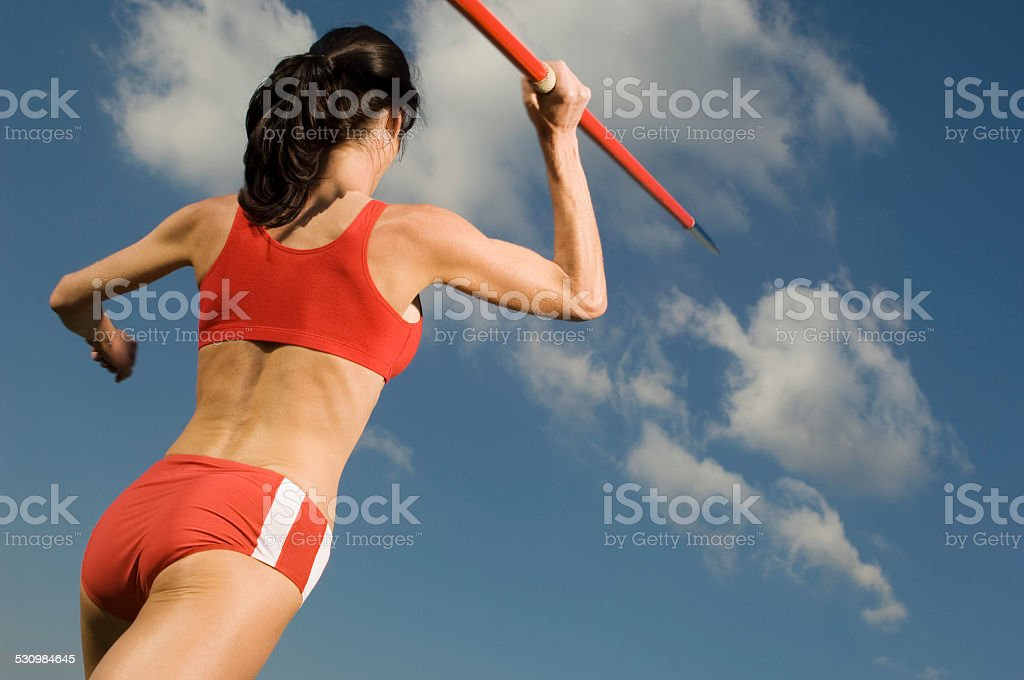 Female athlete throwing javelin stock photo