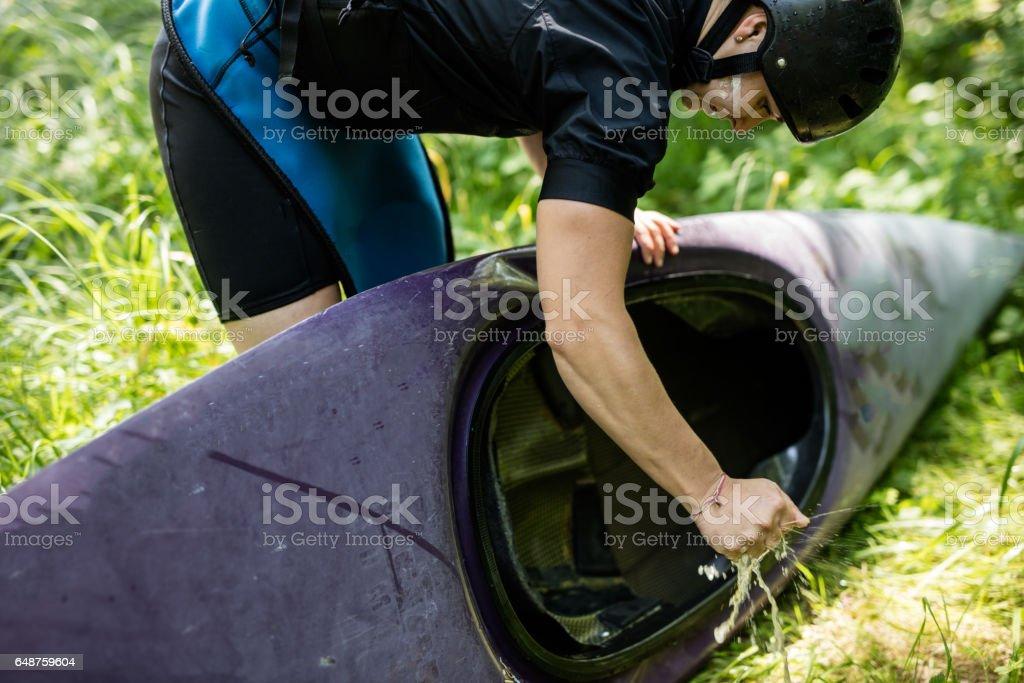 Female athlete washing her kayak stock photo