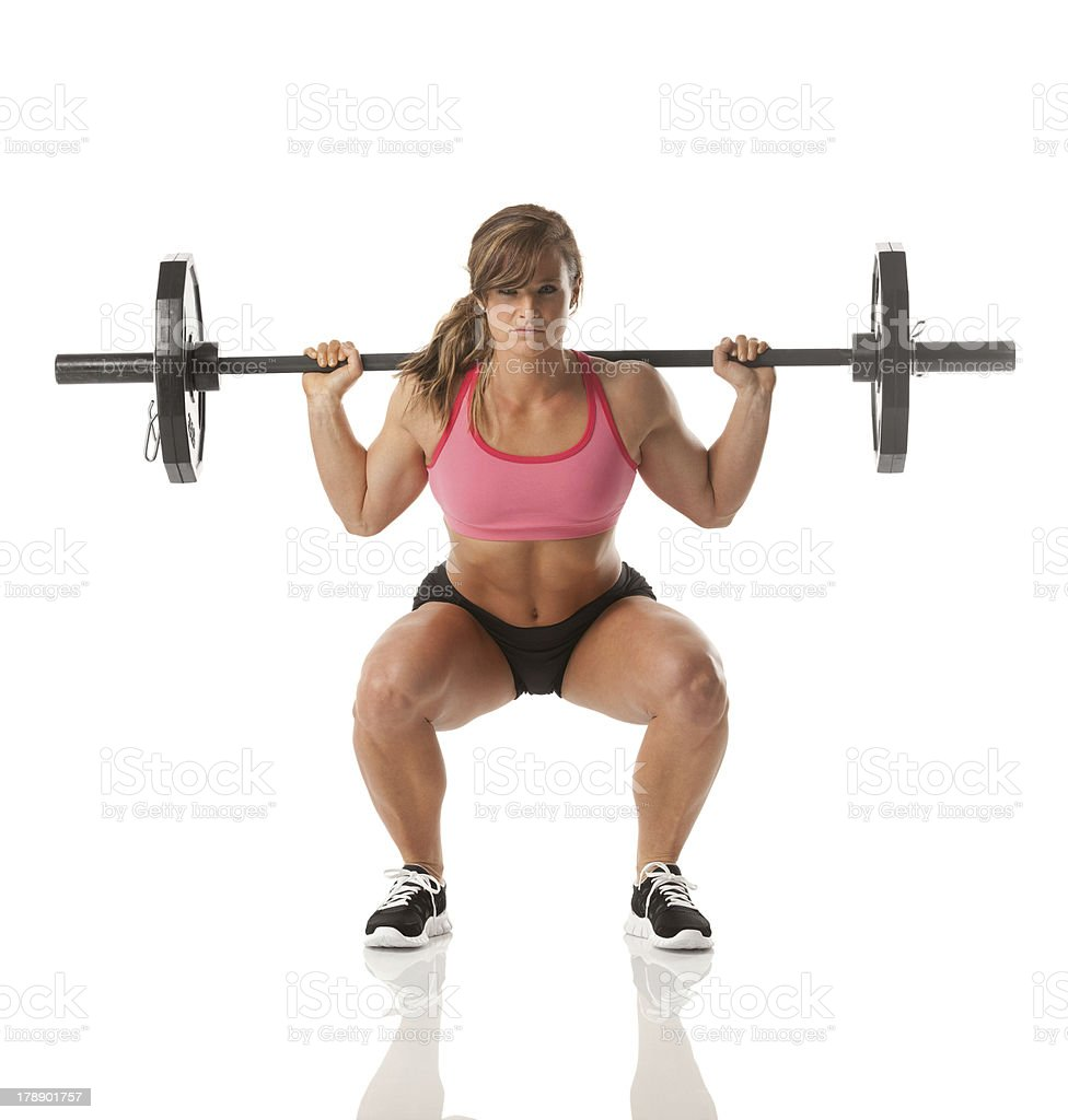 Female athlete weightlifting with barbell royalty-free stock photo