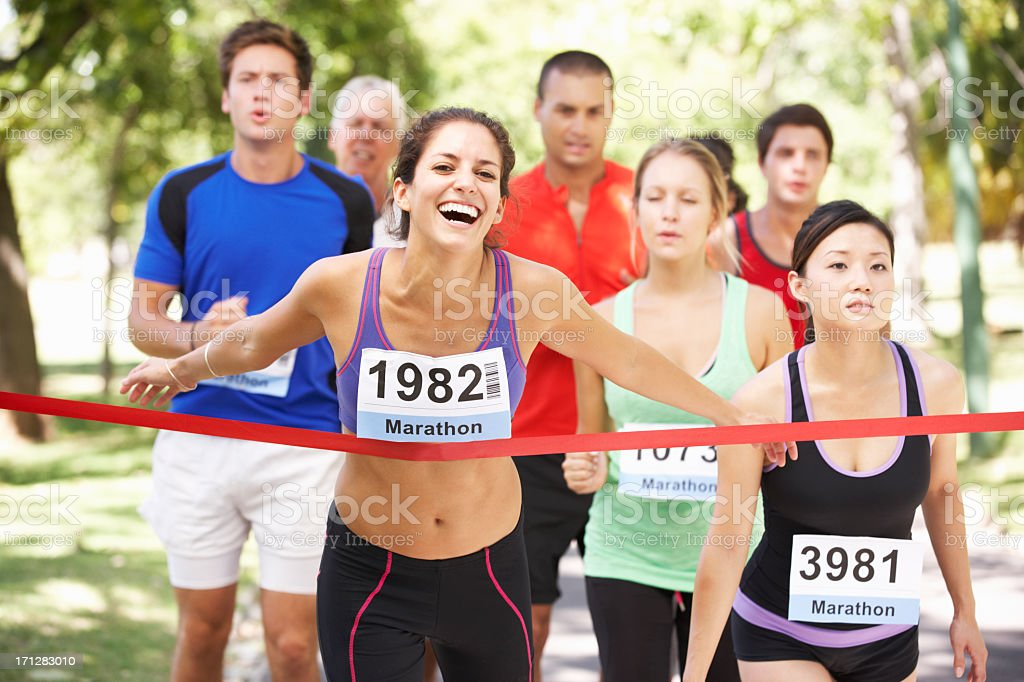 Female Athlete Winning Marathon Race stock photo