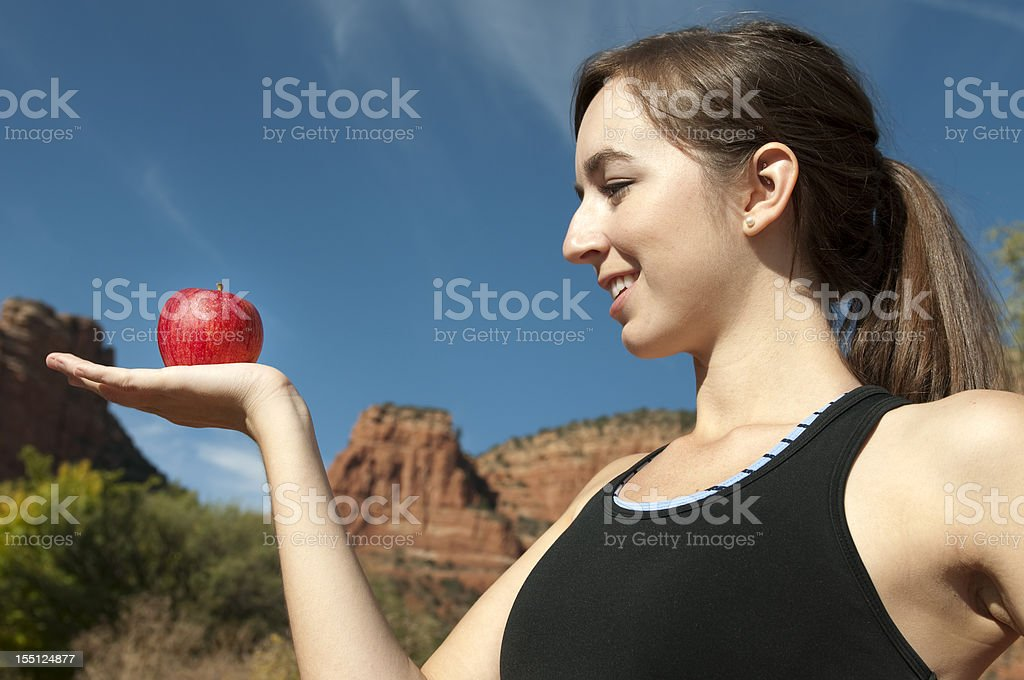 Female Athlete with an Apple royalty-free stock photo