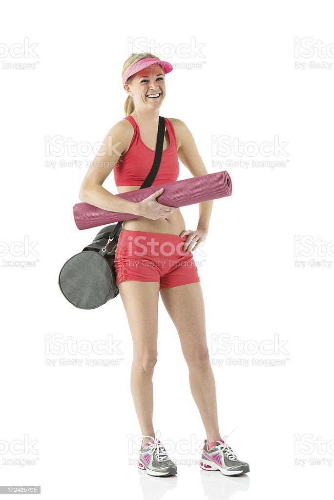 Female athlete with exercise mat and gym bag royalty-free stock photo