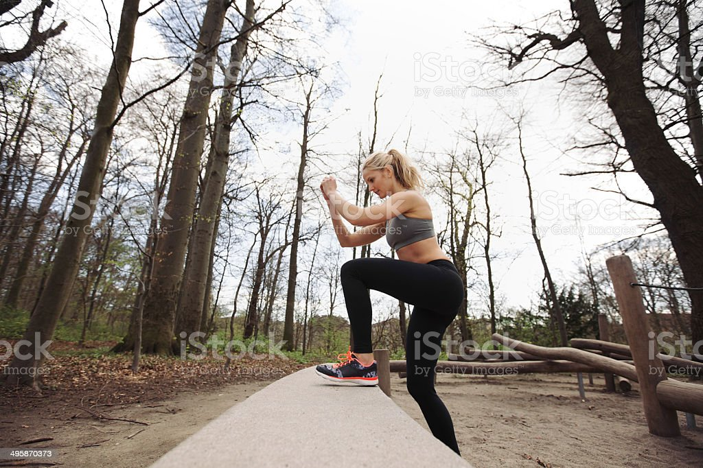 Female athlete working out in nature stock photo