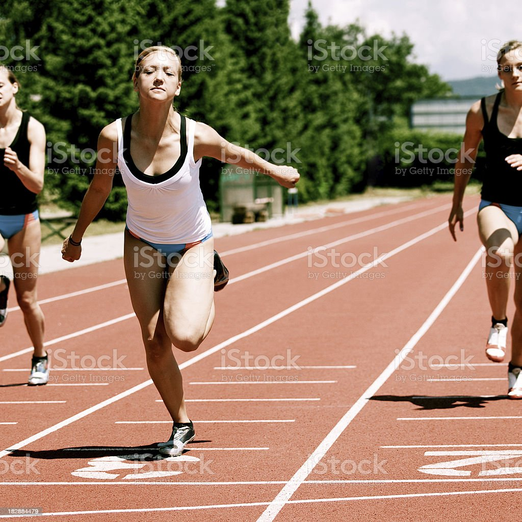 Female athletes at the finish line royalty-free stock photo
