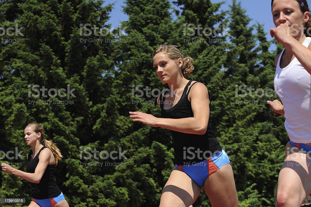 Female athletes sprinting royalty-free stock photo
