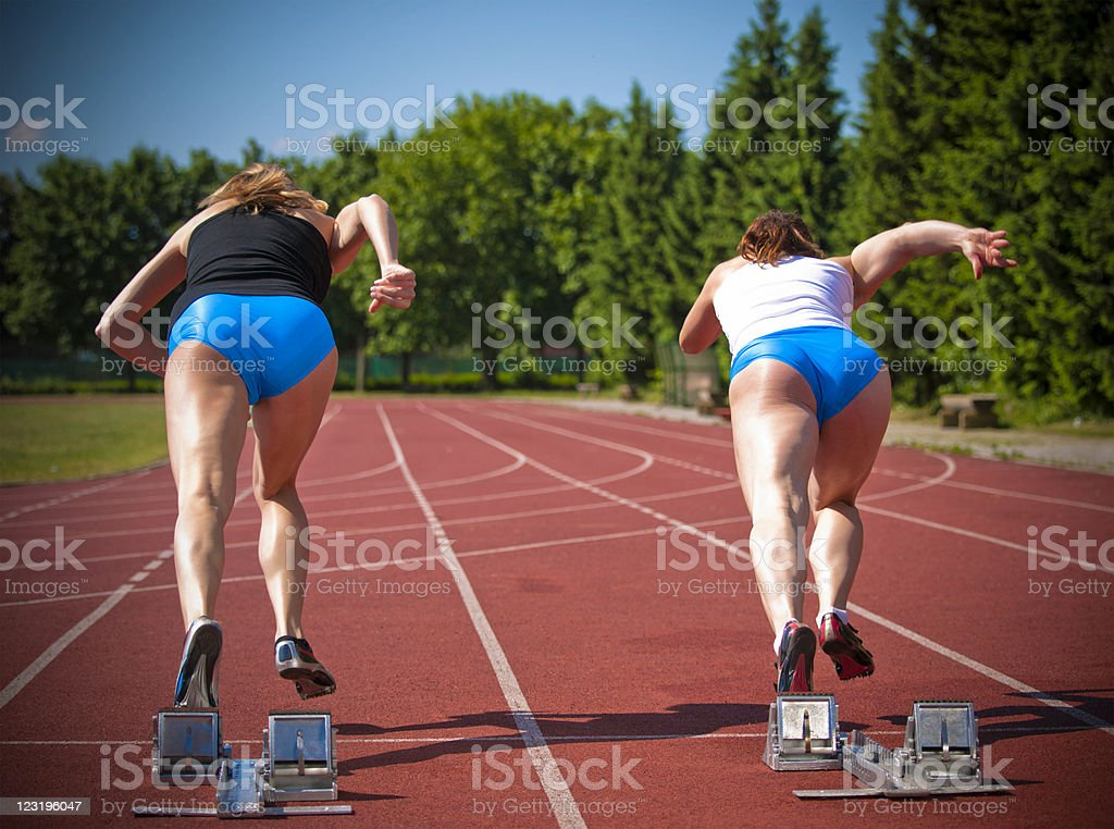 Female athletes starting royalty-free stock photo