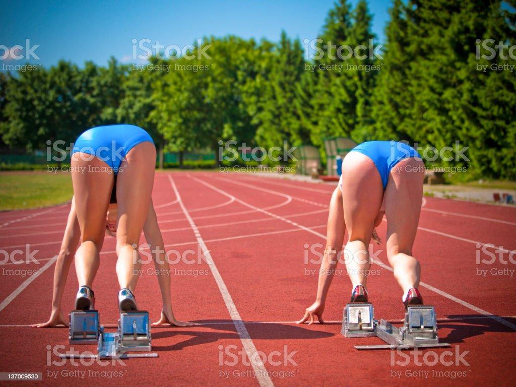Female athletes starting royalty-free stock photo