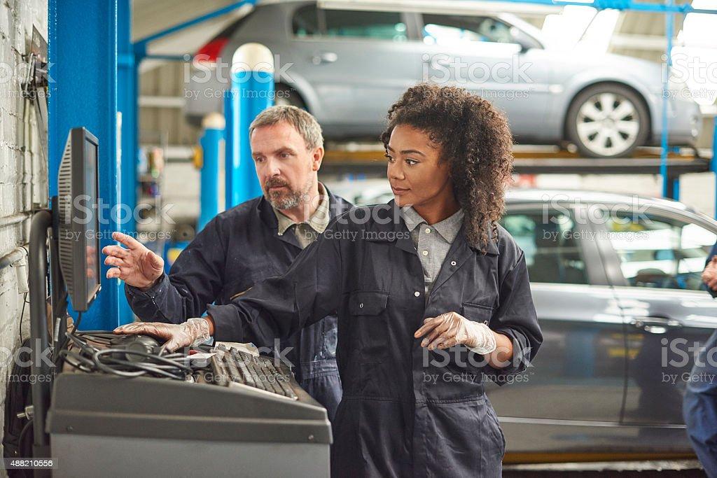 female auto mechanic with her boss stock photo